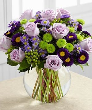 Lavender roses, monte casino asters and hypericum