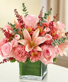 Pink Mixed Flowers in a Ti Leaf Lined Cube Vase