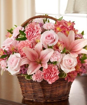 Pink Mixed Flower Sympathy Arrangement in a Wicker Basket