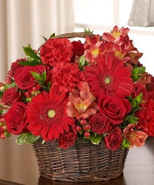 Red Mixed Flower Sympathy Arrangment in a Wicker Basket