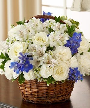 Blue & White Mixed Flower Sympathy Arrangement in a Wicker Basket