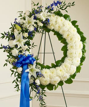 White Sympathy Wreath Accented with Blue & White Mixed Flowers