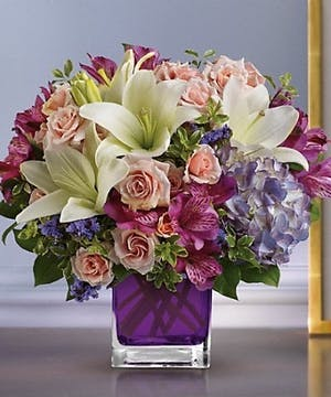 Cube vase filled with Hydrangea, Roses and Lilies