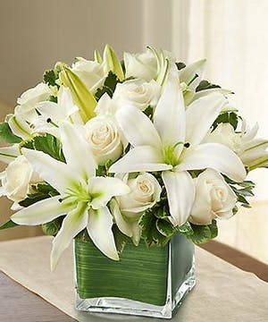 White Roses and White Lilies in a Ti Leaf Lined Cube Vase