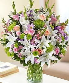 Pastel Multicolor Mixed Flower Sympathy Arrangement in a Cylinder Vase