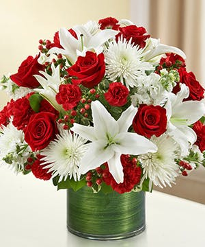 Red & White Mixed Flowers in a Ti Leaf Wrapped Cylinder Vase