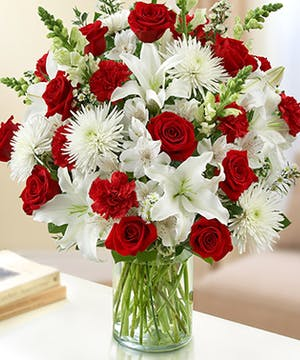 Red & White Mixed Flower Sympathy Arrangement in a Cylinder Vase